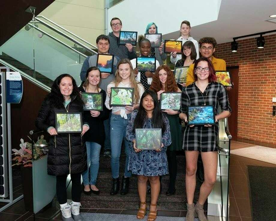 Great Lakes Bay Region students who were winners and finalists in the ninth annual Community Calendar Art Contest sponsored by Hemlock Semiconductor Operations celebrated with a special awards ceremony at HSC headquarters. (Photo provided) / 2018 GLENN PHOTOGRAPHY