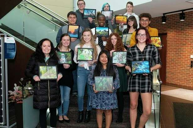 Great Lakes Bay Region students who were winners and finalists in the ninth annual Community Calendar Art Contest sponsored by Hemlock Semiconductor Operations celebrated with a special awards ceremony at HSC headquarters. (Photo provided)