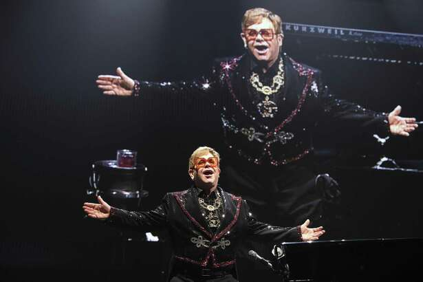 """Elton John takes a bow after opening his """"Farewell Yellow Brick Road"""" concert in San Antonio with """"Bennie and the Jets."""""""