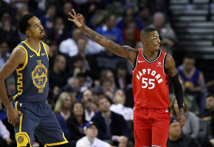 OAKLAND, CA - DECEMBER 12:  Delon Wright #55 of the Toronto Raptors celebrates in front of Shaun Livingston #34 of the Golden State Warriors after a teammate made a three-point basket at ORACLE Arena on December 12, 2018 in Oakland, California.  NOTE TO USER: User expressly acknowledges and agrees that, by downloading and or using this photograph, User is consenting to the terms and conditions of the Getty Images License Agreement.  (Photo by Ezra Shaw/Getty Images)