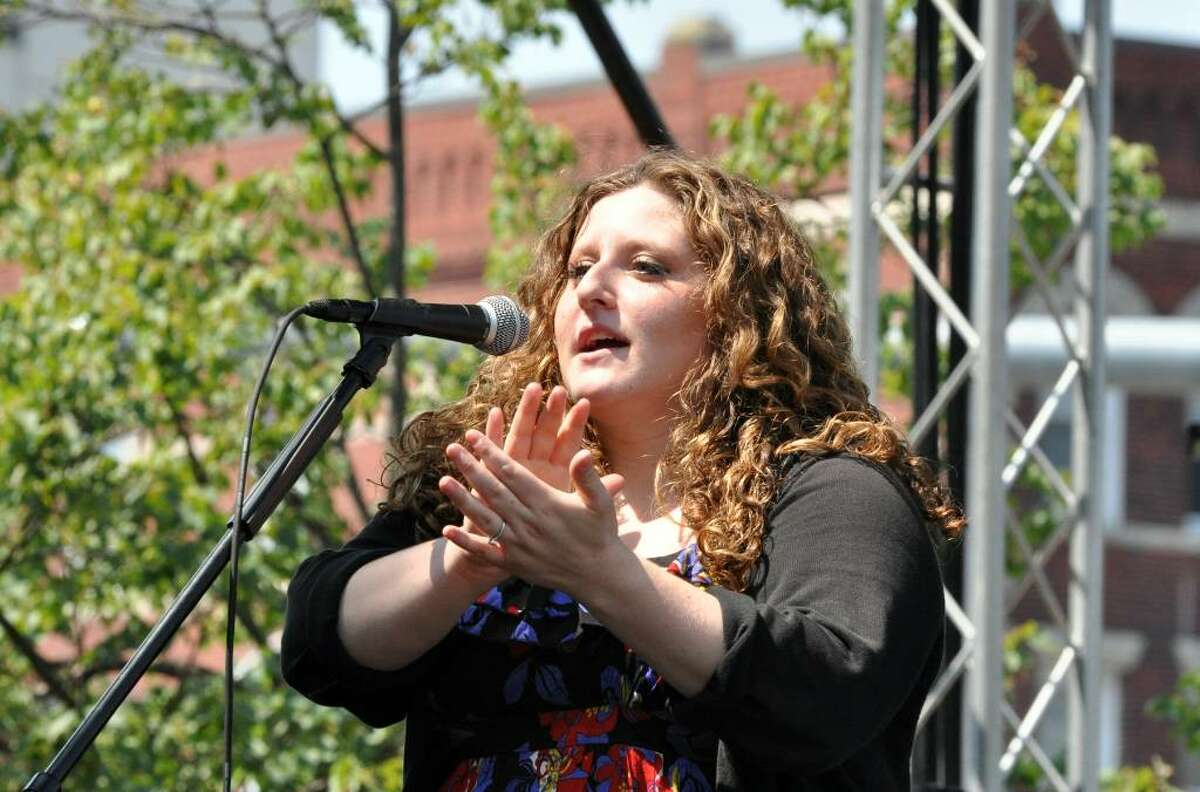 Gaby Carpanzano, organizer of Jump for a Cure, introduces the afternoon's entertainment during Jump for a Cure, a musical theater and band performance to raise money for Sunshine Kids and to Columbia Presbyterian Hospital, at Columbus Park in Stamford on Saturday, June 17, 2010.