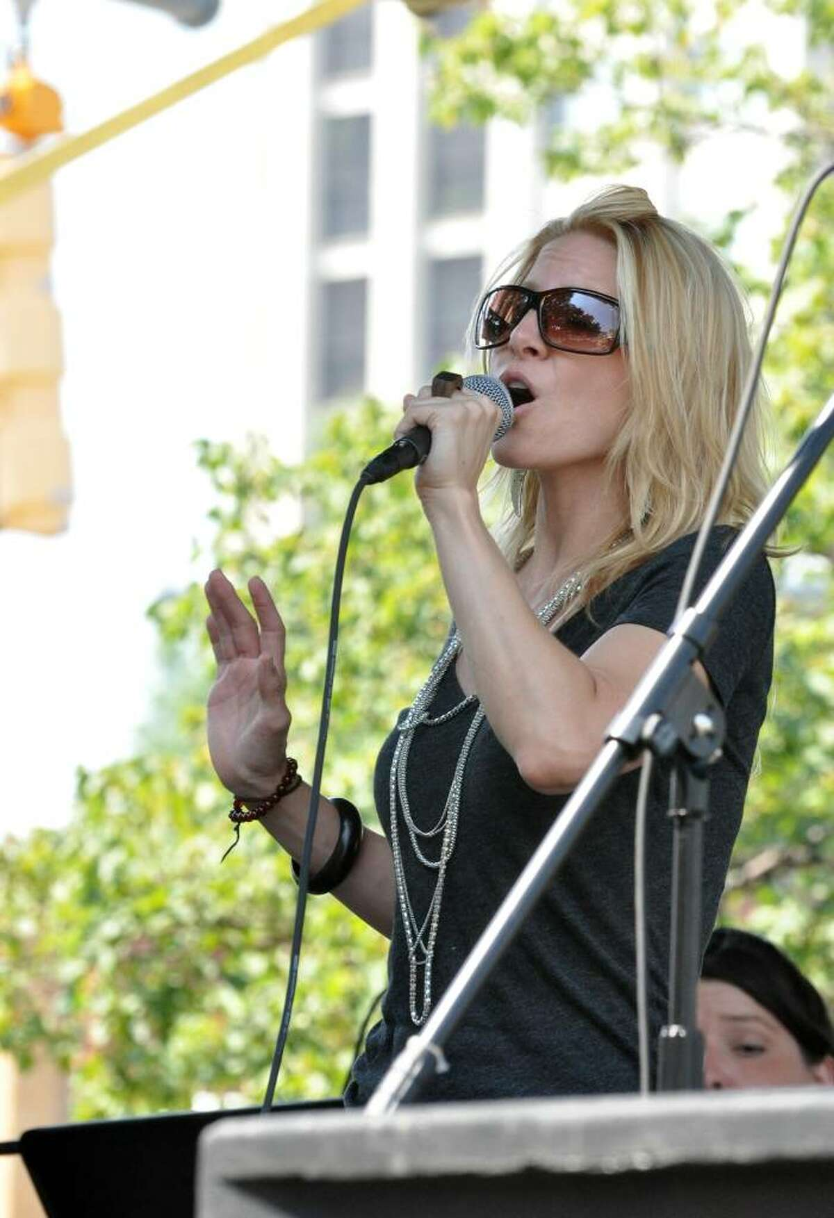 Laura Woyasz, Glinda of the Broadway company of Wicked, performs the song Popular, during Jump for a Cure, a musical theater and band performance to raise money for Sunshine Kids and to Columbia Presbyterian Hospital, at Columbus Park in Stamford on Saturday, June 17, 2010.