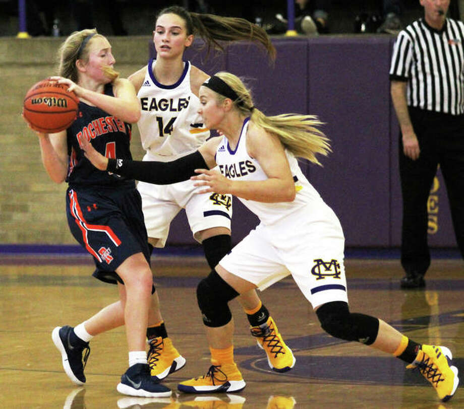 CM's Jenna Christeson (right) and Hannah Sontag apply defensive pressure to Rochester's Abby Walton (left) during a Nov. 24 game at the Taylorville Tournament. The Eagles will be home Saturday as host of the inaugural CM/Adidas Shootout featuring six varsity girls basketball games starting at noon in Bethalto. Photo: Greg Shashack / The Telegraph