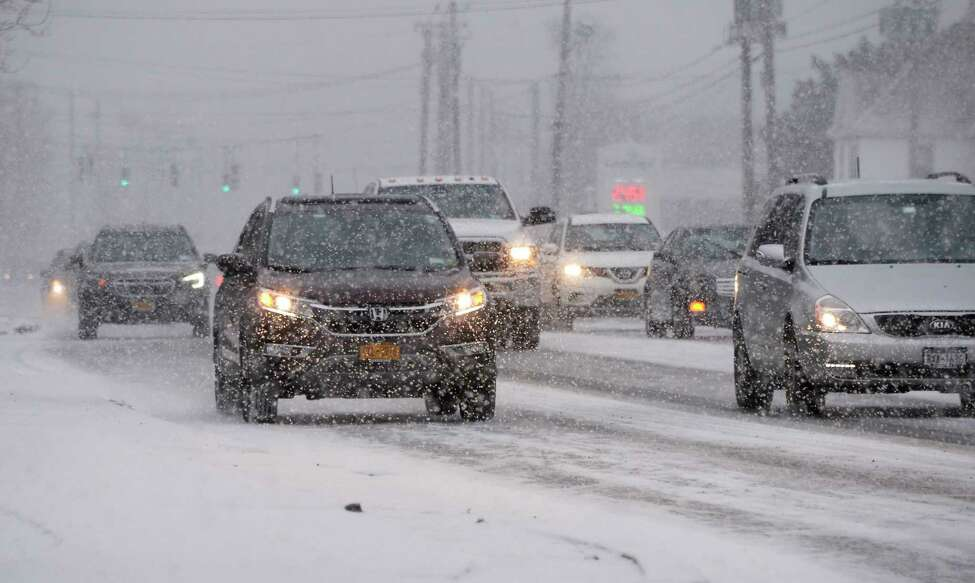 Get ready for a redo: Meteorologist says drivers could face snow squalls during Wednesday's afternoon commute. In this photograph, traffic copes with a late morning snow squall on Route 7, Thursday Dec. 13, 2018 in Colonie, NY. (John Carl D'Annibale/Times Union)