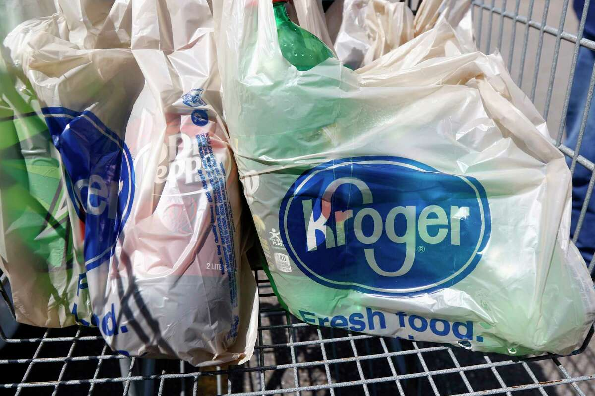 FILE - This June 15, 2017, file photo shows bagged purchases from the Kroger grocery store in Flowood, Miss. The nation's largest grocery chain will phase out the use of plastic bags in its stores by 2025. (AP Photo/Rogelio V. Solis, File)