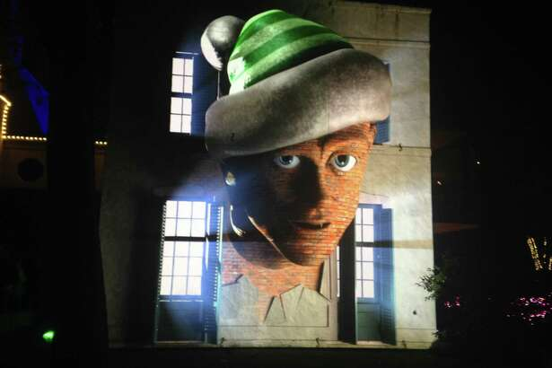 "Miscreant elves appear to pop out of the house, literally, in a 3D-mapped projection that's among the ""Christmas Village at Bayou Bend"" attractions."