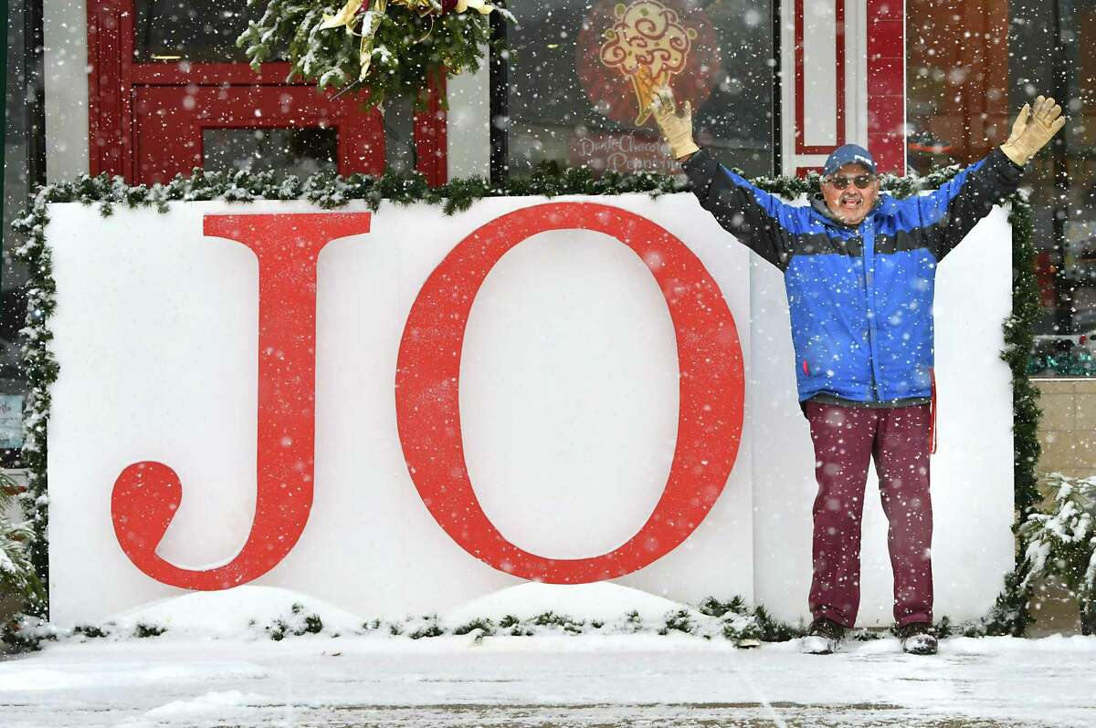John Desorbo stops to spread some joy on his way to the post office through falling snow in Stuyvesant Plaza on Thursday, Dec. 13, 2018 in Guilderland, N.Y. (Lori Van Buren/Times Union)