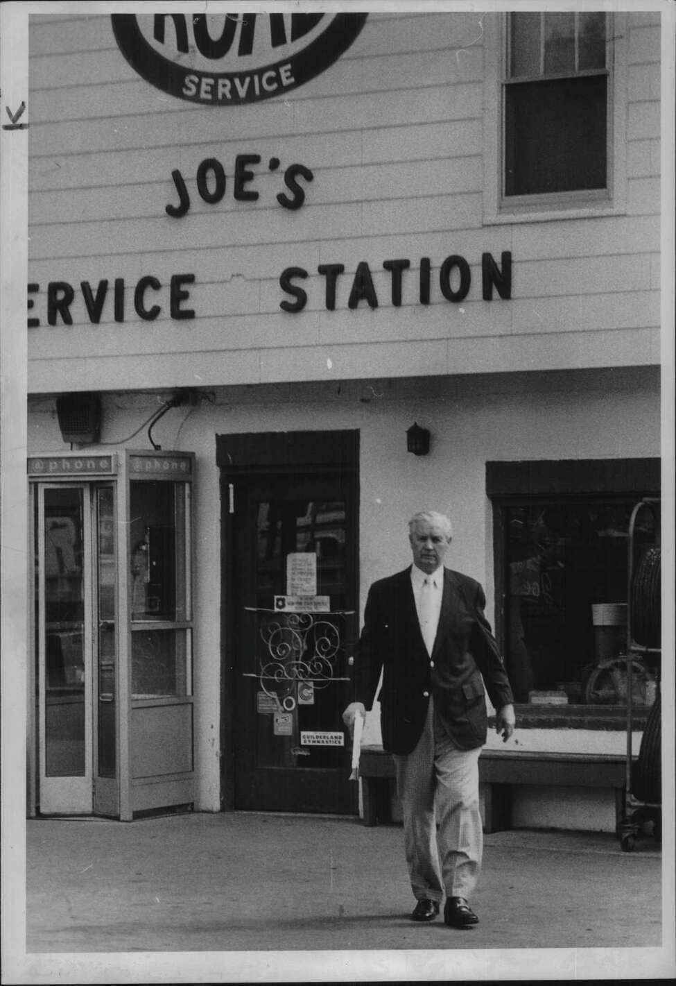 Joe's Service Station, Guilderland, New York _ Kenneth Weafer, Albany County dealer of weight and measures, leaves service station on Route 20 & 146 - Joseph Calabro, owner. June 14, 1979 (Raymond B. Summers/Times Union Archive)