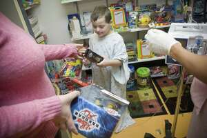 Nabil Riordan, 7, picks out a toy with the help of registered nurse Koleta Glover, at David's Treasure Tree, the children's toy closet in the pediatric wing of the Stamford Hospital on Dec. 17, 2008.