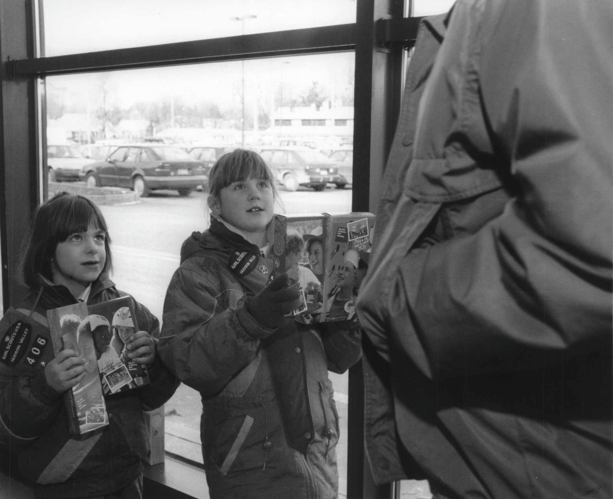Girl Scout vending at Grand Union, Guilderland, New York - marketing of cookies - meeting customers at the market door - Vicky Schelling and Lauren Bussey, both of Troop 406 of the Holy Cross School in Albany, welcoming shoppers to the store with an offer to buy Girl Scout cookies. January 30, 1993 (Luanne Ferris/Times Union Archive)