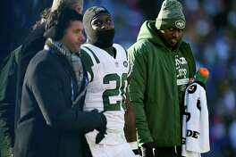 New York Jets running back Isaiah Crowell (20) is escorted from the field after an injury during the first half of an NFL football game, Sunday, Dec. 9, 2018, in Orchard Park, N.Y. (AP Photo/Adrian Kraus)