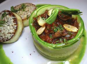 Pork sauce-piquante wrapped in zucchini with gnocchi alla romana from Cookhouse Restaurant.