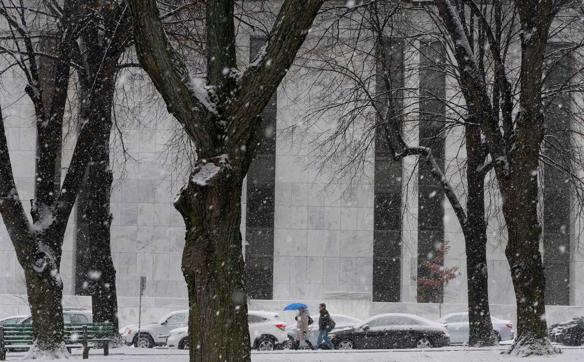 People make their way down State Street as a snow squall came through on Thursday, Dec. 13, 2018, in Albany, N.Y. (Paul Buckowski/Times Union)