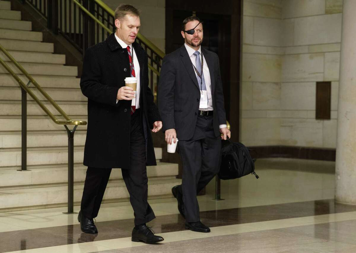 Rep.-elect, Dan Crenshaw, R-Texas., right arrives for member-elect briefings on Capitol Hill in Washington, Thursday, Nov. 15, 2018. (AP Photo/Carolyn Kaster)
