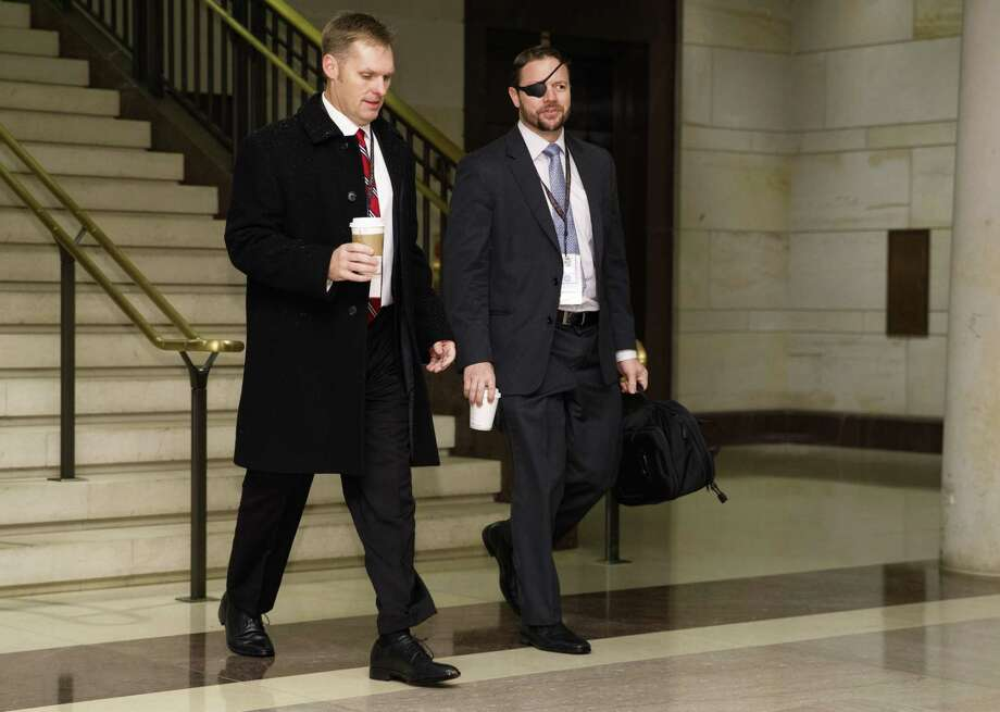 Rep.-elect, Dan Crenshaw, R-Texas., right arrives for member-elect briefings on Capitol Hill in Washington, Thursday, Nov. 15, 2018. (AP Photo/Carolyn Kaster) Photo: Carolyn Kaster, STF / Associated Press / Copyright 2018 The Associated Press. All rights reserved