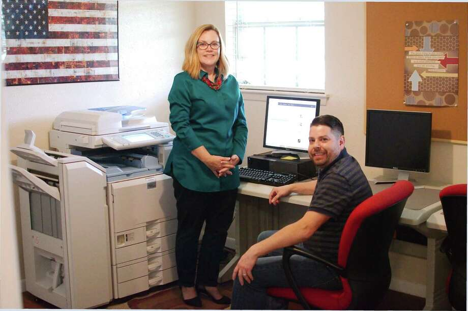 Family Promise Executive Director Gayle Nelson and IT resource manager Joseph Dupre help homeless families who coming to the group's day center to use resources such as a copier, phones and computers. Photo: Kirk Sides / Staff Photographer / © 2018 Kirk Sides / Houston Chronicle