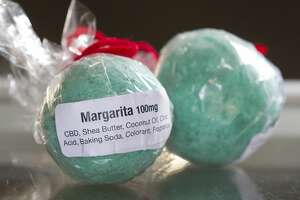 The newly opened Ojas CBD shop in Spring sells bath bombs contraining Hemp-derived CBD oil.