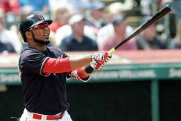 Cleveland Indians' Edwin Encarnacion watches his ball after hitting a two run home run off Texas Rangers starting pitcher Matt Moore in the second inning of a baseball game, Wednesday, May 2, 2018, in Cleveland. Francisco Lindor scored on the play. (AP Photo/Tony Dejak)