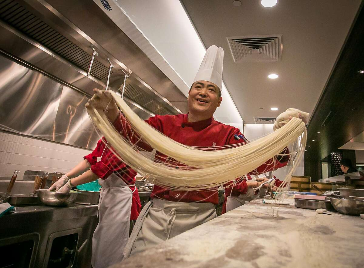 Executive Chef Tony Wu tosses noodles at My China restaurant in San Francisco, Calif. on Saturday, January 19th, 2013.