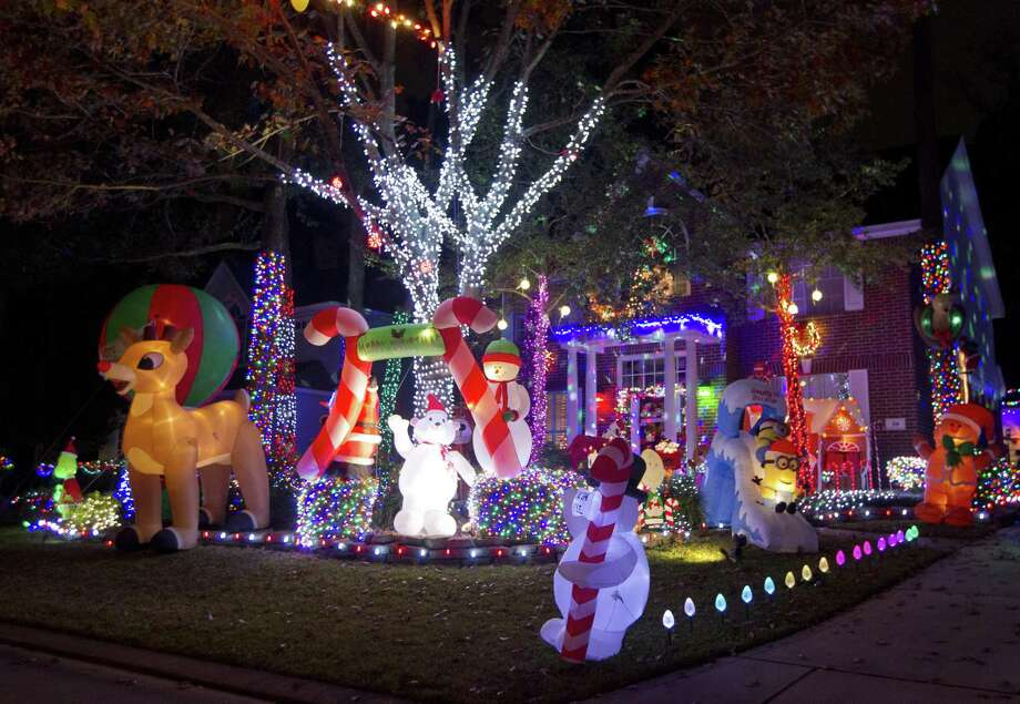 Holiday Lights Adorn The Home Of Vivian And Ross Kruchten On Edgemire Place Wednesday