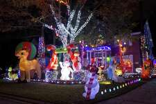 Holiday lights adorn the home of Vivian and Ross Kruchten on Edgemire Place, Wednesday, Dec. 12, 2018, in The Woodlands.