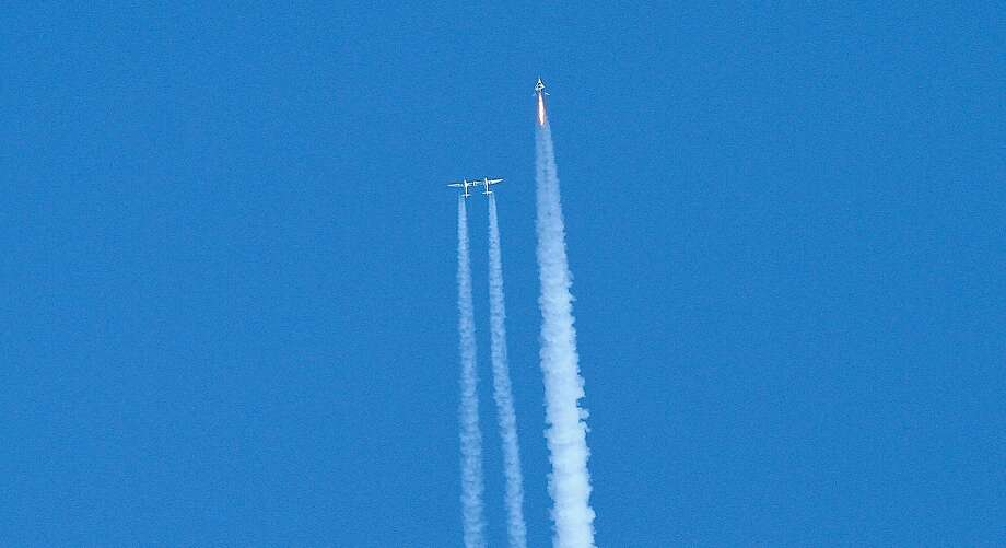 Top and above: A Virgin Galactic spaceship called Unity reaches space for the first time. It was in its fourth powered flight from Mojave (Kern County). The craft reached an altitude of 51 miles before beginning its gliding descent. Photo: Matt Hartman / Associated Press