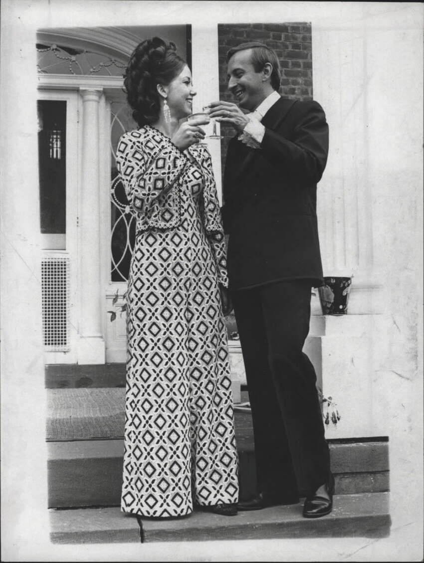 Mr. and Mrs. Timothy O'Hearn celebrate with a toast outdoors. July 1969 (Times Union Archive)