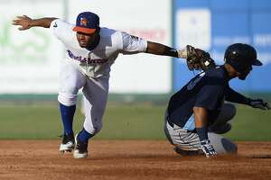 RockHounds' Richie Martin tags Corpus Christi's Randy Cesar out at second base June 13, 2018, at Security Bank Ballpark. James Durbin/Reporter-Telegram
