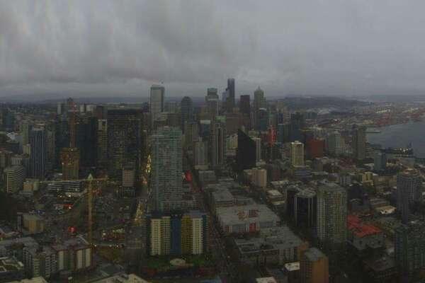 A dark and gloomy Seattle skyine on Dec. 11, 2018 (Photo courtesy: Space Needle Web Camera)