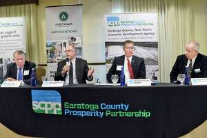 Panelists, from left, John Allen, Partner at Whiteman, Osterman & Hanna LLP, Richard Sleasman, President and Managing Director of CBRE-Albany, Matthew Harris, Vice President, Residential Lending, Adirondack Trust, and Tom Roohan, President of Roohan Realty discuss the Saratoga county real estate index Thursday Dec. 13, 2018 in Malta, NY.  (John Carl D'Annibale/Times Union)