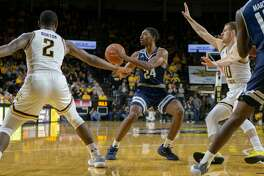 WICHITA, KS - NOVEMBER 25: Rice Owls guard Chris Mullins (24) passes the ball during the college basketball game against the Wichita State Shockers on November 25, 2018 at Charles Koch Arena in Wichita, Kansas. (Photo by William Purnell/Icon Sportswire via Getty Images)