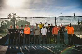 The Treasure Island skate park builders after completing a concrete pour at their DIY skate park.