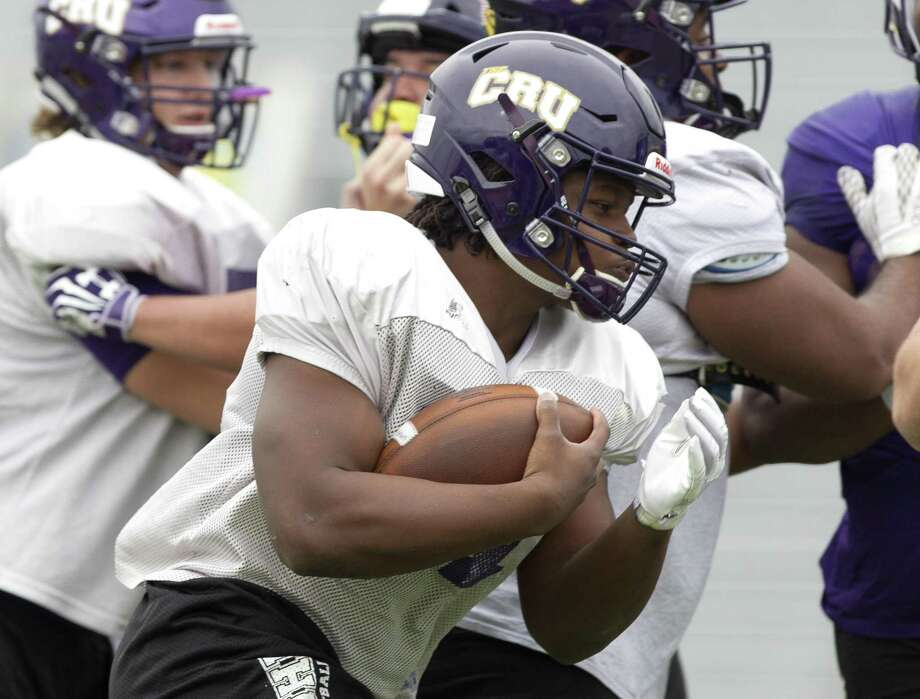 University of Mary Hardin Baylor running back Markeith Miller (21) runs the ball during practice at Moorhead Stadium, Wednesday, Dec. 12, 2018, in Conroe. Photo: Jason Fochtman, Houston Chronicle / Staff Photographer / © 2018 Houston Chronicle