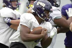 University of Mary Hardin Baylor running back Markeith Miller (21) runs the ball during practice at Moorhead Stadium, Wednesday, Dec. 12, 2018, in Conroe.
