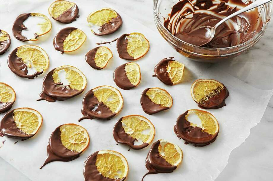 Chocolate-Dipped Orange Crisps. Photo: Photo By Tom McCorkle For The Washington Post. / The Washington Post