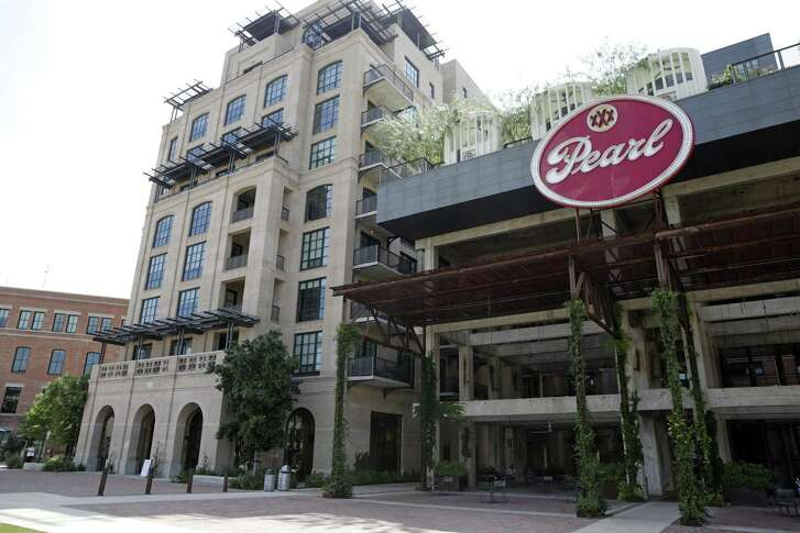 San Antonio officials approved changes to two programs that have more than $100 million worth of incentives to developers building housing projects downtown — including the upscale Cellars at Pearl apartment complex.