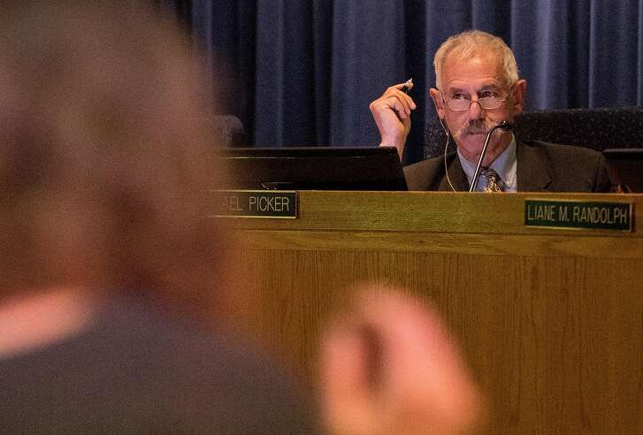 California Public Utilities Commission President Michael Picker listens during the public comment portion of a California Public Utilities Commission meeting San Francisco, Calif. Wednesday, Nov. 28, 2018 surrounding the fate of PG&E following multiple deadly wildfires.