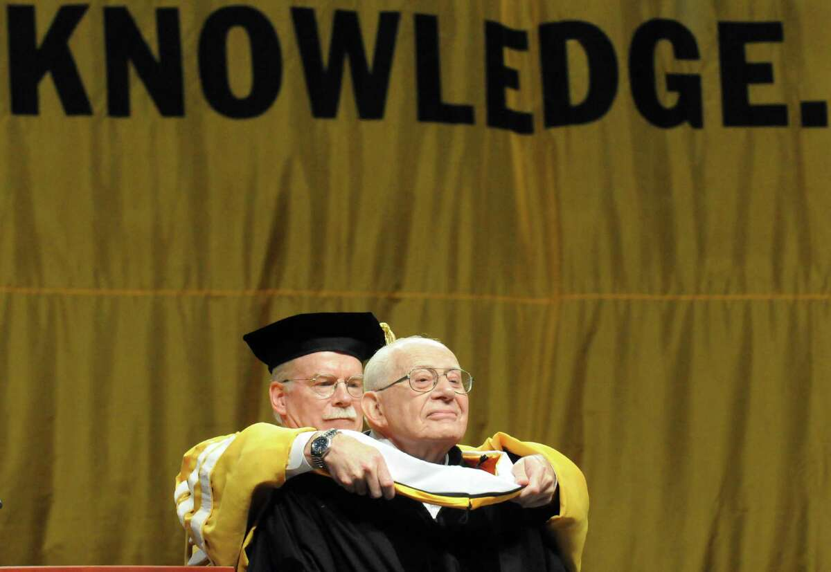Times Union Publisher George R. Hearst III presents Harry Rosenfeld Times Union editor-at-large with a Doctor of Humane Letters during the College of Saint Rose 91st Annual Commencement at the Times Union Center on Saturday May 10, 2014 in Albany, N.Y. (Michael P. Farrell/Times Union)