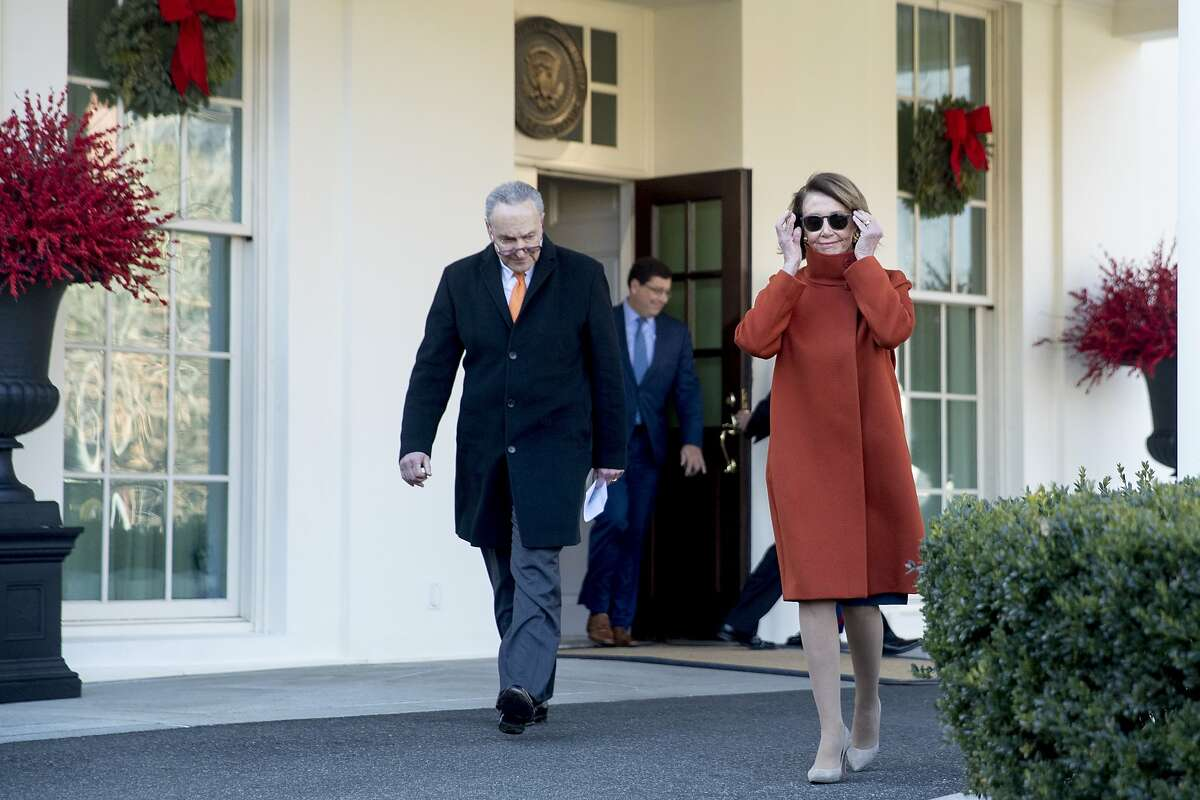 Speaker Nancy Pelosi of Calif. and Senate Minority Leader Sen. Chuck Schumer of N.Y. walk out of the West Wing to speak to members of the media outside of the White House in Washington, Tuesday, Dec. 11, 2018, following a meeting with President Donald Trump. Click through the gallery for reactions to Pelosi's hypothetical presidency.