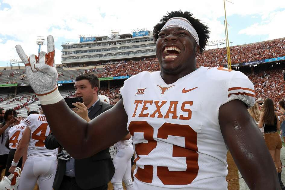 DALLAS, TX - OCTOBER 06: Jeffrey McCulloch #23 of the Texas Longhorns celebrates a win against Oklahoma Sooners in the 2018 AT&T Red River Showdown at Cotton Bowl on October 6, 2018 in Dallas, Texas. (Photo by Ronald Martinez/Getty Images)