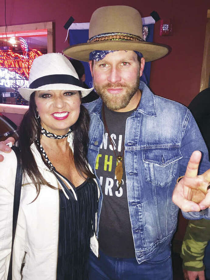 ReLoved Leather designer Kenneathia Hagen, of Edwardsville, Illinois, with singer Drake White, a longtime client of reLoved Leather. Photo: For The Telegraph