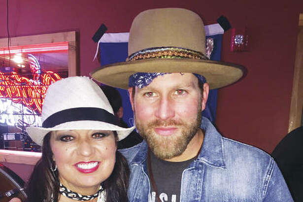 ReLoved Leather designer Kenneathia Hagen, of Edwardsville, Illinois, with singer Drake White, a longtime client of reLoved Leather.