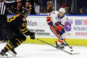 The Sound Tigers' Travis St. Denis looks to pass the puck as Providence's Desmond Bergin (43) intercepts on Dec. 2 at the Webster Bank Arena in Bridgeport.