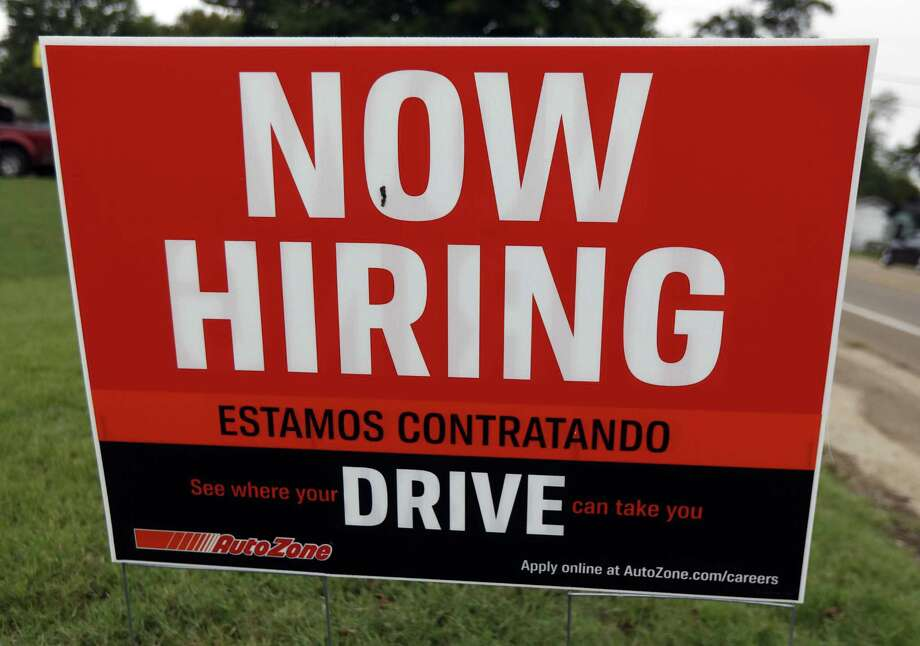 A bilingual help wanted sign for Auto Zone, a retailer of aftermarket automotive parts and accessories, is posted in Canton, Miss., Sept. 27, 2018. Readers debate employers' desire to have bilingual workers. Photo: Rogelio V. Solis /Associated Press / Copyright {2018} The Associated Press. All rights reserved