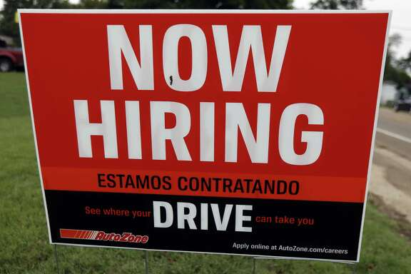 A bilingual help wanted sign for Auto Zone, a retailer of aftermarket automotive parts and accessories, is posted in Canton, Miss., Sept. 27, 2018. Readers debate employers' desire to have bilingual workers.