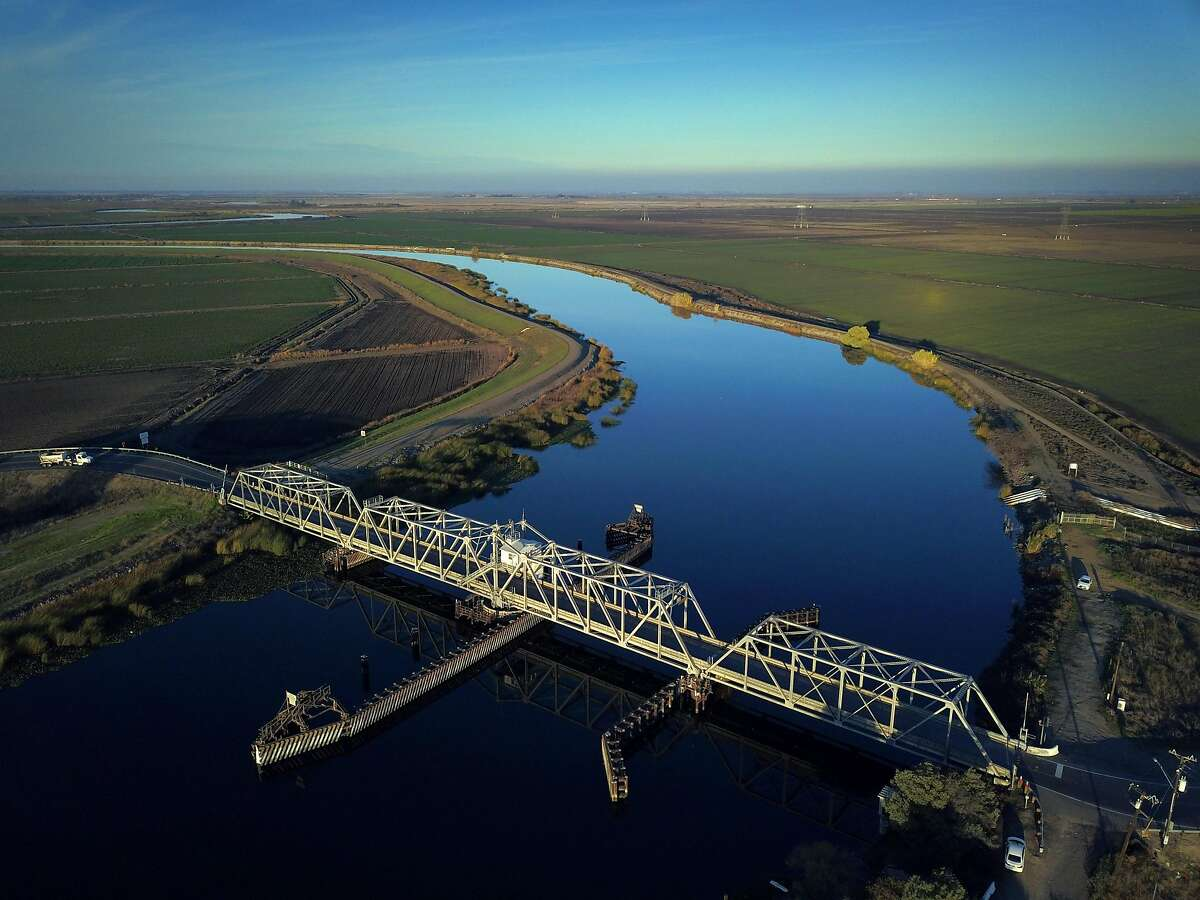 Old River with its bridge visible at the bottom, runs through farmland in the Sacramento-San Joaquin Delta outside Discovery Bay, Calif., on Tuesday, December 11, 2018. On Wednesday, the Legislature is expected to vote on a massive water bill which could decide the fate of the state's water, pitting environmentalists and sportsmen against farmers and city dwellers. No matter how the vote goes, someone will be unhappy, either the cities and suburbs, or the ranchers/farmers or the environmentalists.