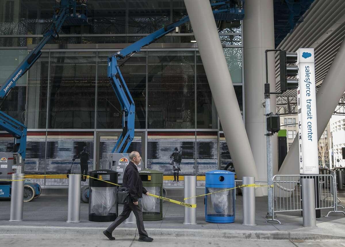 A man walks past facade construction at the Transbay Transit Center along Natoma Street in San Francisco, Calif. Tuesday, Nov. 20, 2018.