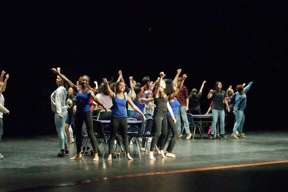 "Students rehearse a scene from ""High School Musical on Stage!"" at Manvel High School."