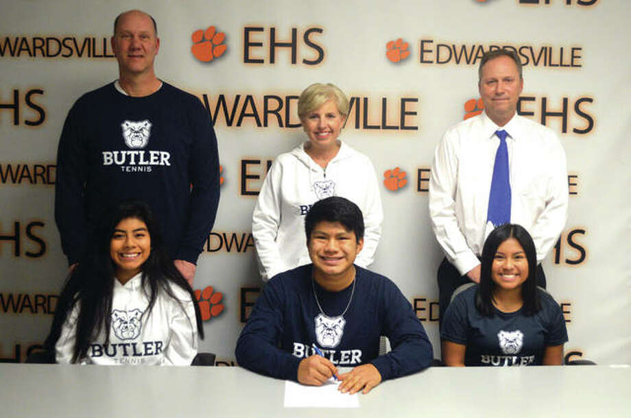 Edwardsville senior Zach Trimpe signed to play tennis at Butler University. In the front, from left to right, are sister Chloe Trimpe, Zach Trimpe and sister Grace Trimpe. In the back, from left to right, are father Trevor Trimpe, mother Dina Trimpe and EHS coach Dave Lipe. Photo: Scott Marion/Intelligencer