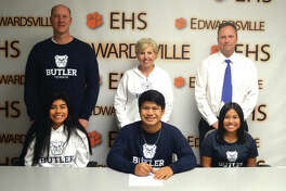 Edwardsville senior Zach Trimpe signed to play tennis at Butler University. In the front, from left to right, are sister Chloe Trimpe, Zach Trimpe and sister Grace Trimpe. In the back, from left to right, are father Trevor Trimpe, mother Dina Trimpe and EHS coach Dave Lipe.